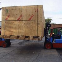 Forklift loading a crate