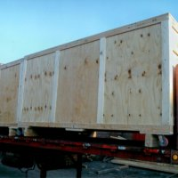 Crating loaded onto truck bed